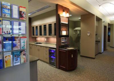 smile quest hallway, cabinets, brochures